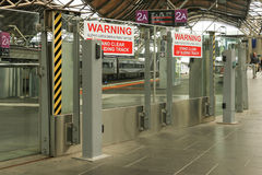 Red and white warning, sliding gates open without notice signs at Southern Cross Station, Melbourne