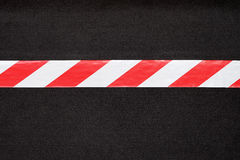 Red and white warning tape Royalty Free Stock Images