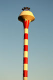 Red and white water tower. With blue sky Royalty Free Stock Photo