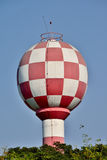 Red and white water tower. Stock Image