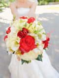 Red and White Wedding Bouquet. In bride's hands Royalty Free Stock Photography