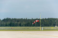 Red and white windsock at an airport runway Stock Photography