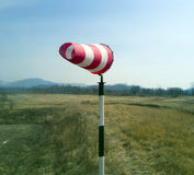 Red-white windsock indicating wind Royalty Free Stock Photography