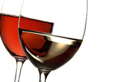 Red and white wine. Two wine glasses containing red and white wine, isolated Stock Image