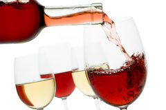 Red and white wine. Red wine poured in a glass isolated on white background royalty free stock images