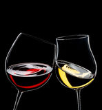 Red and white wine. Glasses, isolated over black, space for copy royalty free stock images