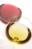 Red and white wine. Two glasses of red and white wine close-up on white background royalty free stock images