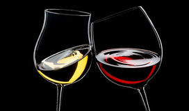 Red and white wine. Glasses, isolated over black royalty free stock photo