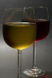 Red and white wine. Close up of red and white wine on dark background Stock Images