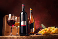 Red and white wine. In mood ligting stock photos