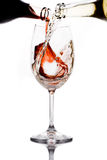 Red and white wine. Being poured into a wine glass royalty free stock photography