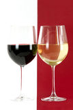 Red and white wine. 2 glasses of a red and white wine at white and red background stock photos