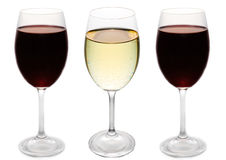 Red and white wine. Three glasses of wine with white wine in the middle Royalty Free Stock Image