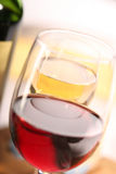 Red and white wine. Two glasses of wine and a part of a bottle, close up, macro, soft focus Stock Image