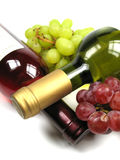 Red and white wine. And some grapes royalty free stock image