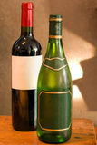Red and white wine bottle with empty labels Stock Photos