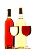 Red and White Wine Bottles and Filled Glasses Royalty Free Stock Photos