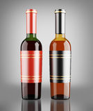 Red and white wine bottles over dark gray background Stock Photo