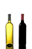 Red and white wine bottles with reflection Stock Image