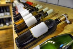Red and white wine in bottles Stock Images
