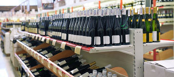 Red and white wine in bottles Stock Image