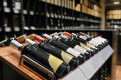 Red and white wine in bottles Stock Photos