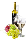 Red and white wine, with bunches of grapes Stock Photography