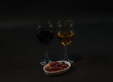 Red and white wine in the glass with grapes in a ceramic bowl,on Royalty Free Stock Photo