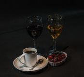 Red and white wine in the glass with grapes in a ceramic bowl an Royalty Free Stock Photo