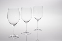 Red or white wine glasses. 3 empty wine glasses  on grey or white background Royalty Free Stock Images