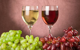 Red and white wine. In wine glasses royalty free stock image