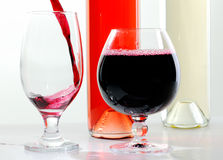 Red and white wine in glasses and bottles Royalty Free Stock Photography