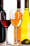 Glasses of red and white wine on white background. Red white wine glasses color background festive Stock Photos