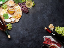 Red and white wine, grape, cheese and sausages Stock Image