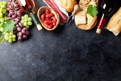 Red and white wine, grape, cheese and sausages Stock Images