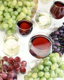 Red and white wine and grapes Stock Photography