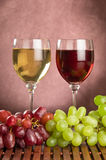 Red and white wine with green and red grapes. White and red wine with green and red grapes royalty free stock images