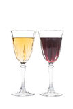 Red and white wine in luxurious crystal glasses Stock Photography