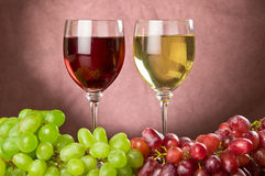Red and white wine with red and green grapes. White and red wine with red and white grapes royalty free stock photo