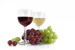 Red and white wine with red and white grapes Royalty Free Stock Images