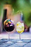 Red and white wine sangria cocktail drinks on table stock photos