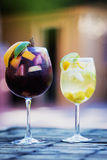 Red and white wine sangria cocktail drinks on table royalty free stock image