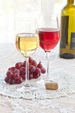 Red and white wine. In tall stem glasses stock photography