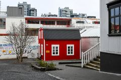Red and White Wooden House Beside Brown Tree Stock Photography