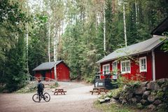 Red and White Wooden Houses Surrounded With Trees stock photos