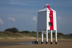 Red and white wooden lighthouse Royalty Free Stock Photo