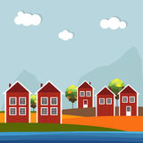 Red And White Wooden Scandinavian Houses. Autumn Theme. Red And White Wooden Scandinavian Houses. Colorful Autumn Theme Royalty Free Stock Photo