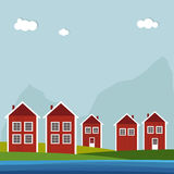 Red And White Wooden Scandinavian Houses. Summer Theme. Red And White Wooden Scandinavian Houses. Summer Theme With Sea And Snowfall Royalty Free Stock Image