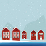 Red And White Wooden Scandinavian Houses. Winter Theme. Red And White Wooden Scandinavian Houses. Winter Theme With Sea And Snowfall Stock Photography