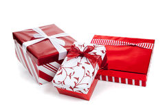 Red and white wrapped Christmas present on  white Stock Photography